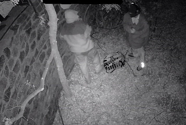 Suspects recorded on surveillance video attempt to steal cash from the Shrine of the Mountain Church donation box in Yarnell on May 4. (YCSO/Courtesy)