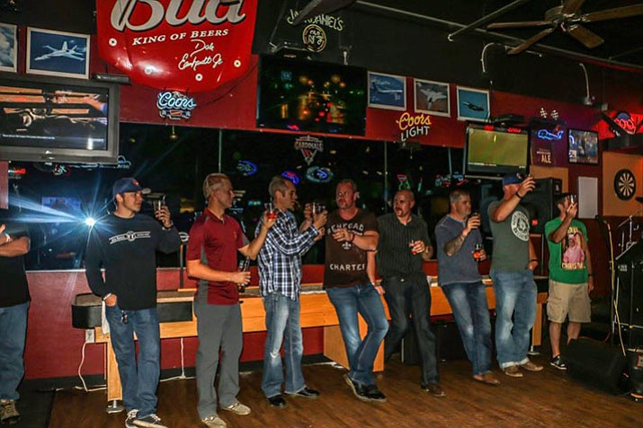 Toasting during the Gear up event to raise funds for firefighter foundation. (Courtesy Photo)