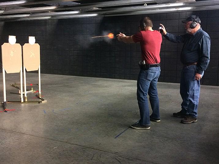 Zach DeJesus fires at targets at Prescott Gun Club. (Jason Wheeler/Courier)