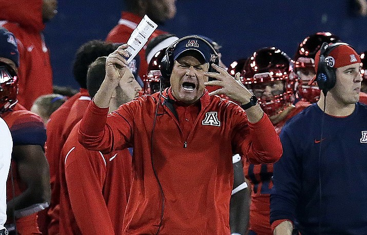 In this Nov. 25, 2016, file photo, Arizona coach Rich Rodriguez reacts after a penalty during the second half of the teams game against Arizona State in Tucson, Ariz. (Rick Scuteri/AP, File)