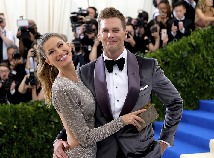 "In this May 1, 2017, file photo, Gisele Bundchen, left, and Tom Brady attend The Metropolitan Museum of Art's Costume Institute benefit gala celebrating the opening of the Rei Kawakubo/Comme des Garçons: Art of the In-Between exhibition in New York. Bundchen told ""CBS This Morning"" in an interview that aired May 17, 2017, that Brady suffered a concussion last year. (Charles Sykes/AP, File)"