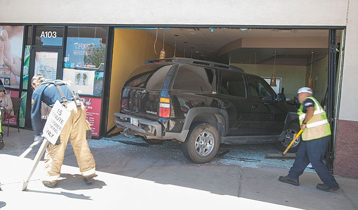A driver lost control of his vehicle and drove into the unopened Alfonso's Restaurant in the Fry's Shopping Center on Willow Creek Road Thursday, May 18 in Prescott.  (Les Stukenberg/Courier)