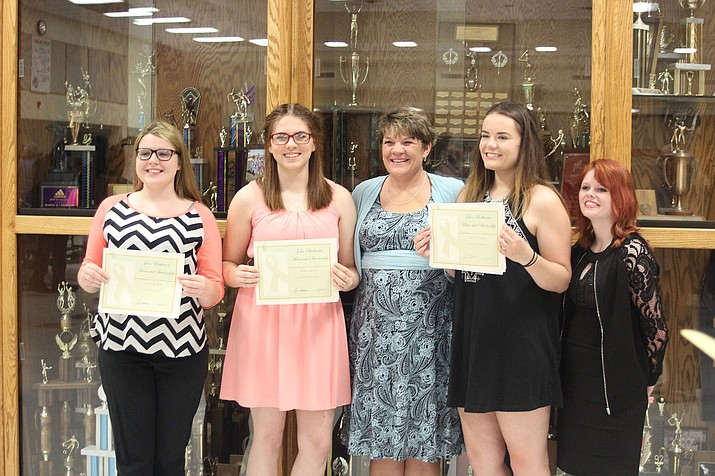 Kingman High guidance counselor Anne Bathauer, center, poses with, from left, Zoe Jenkins, Dawn Orcutt, Ashton Grigg and Katrina Sears Wednesday night during the Senior Awards ceremony at the high school auditorium.