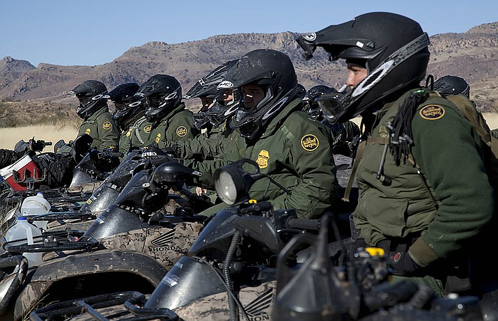 Border Patrol agents line up in formation on motor bikes in the Tucson sector. A Senate committee gave preliminary approval to a measure that would lift a lie detector requirement of some Border Patrol applicants, as the agency works to hire thousands of officers. (Photo by Josh Denmark/Customs and Border Protection)