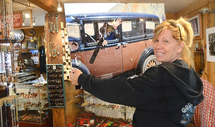 Jeannie Leffew, Robertson's stepdaughter who is current owner of the Gold King Mine, shows a photo of Don Robertson inside of the mines gift shop. VVN/Vyto Starinskas