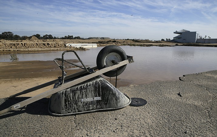 In this Jan. 13, 2016, file photo, a wheelbarrow sits at the site of the former Hollywood Park in Inglewood, Calif., where a stadium for NFL football Los Angeles Rams is being built. (Damian Dovarganes/AP, File)