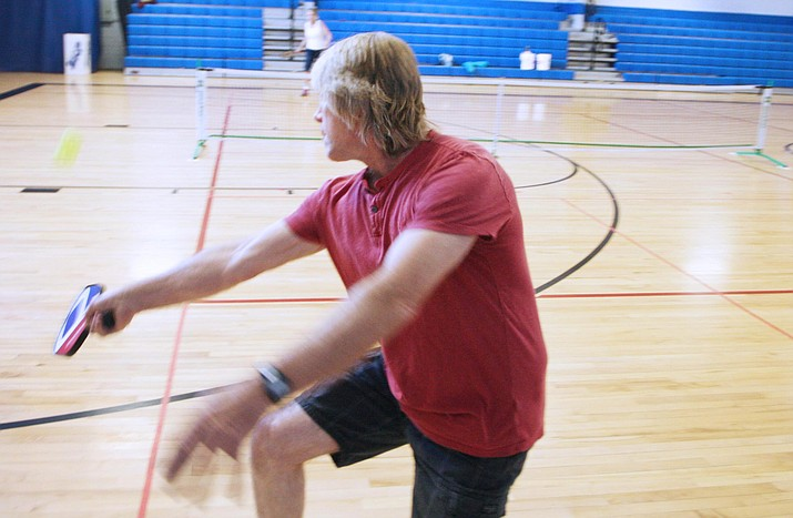 A competitive racquetball player from 1978-1993, Camp Verde resident Bobby Corcorran plays pickleball with fellow Camp Verdean Janet Jones. (Photo by Bill Helm)