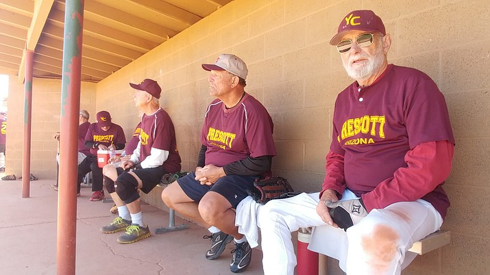 Jeff Spielman, right, watches from the dugout at Pioneer Park in Prescott as Yavapai Cantina faces the Kokopelli Scorpions in the opening round of the Tobin-Glick Tournament on Thursday afternoon. Cantina of the 70s age division finished the first day of the two-day tournament with a 0-1-1 record. Kokopelli of the 75s age division went 1-2. (Doug Cook/Courier)