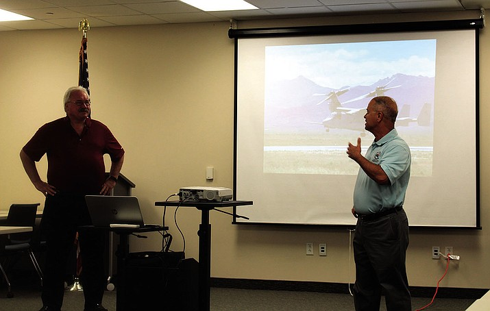 Bob Riley (left), Director, Economic Development for Kingman Airport Authority and workshop facilitator, Bill Pupo, discuss a point at Thursday's meeting.