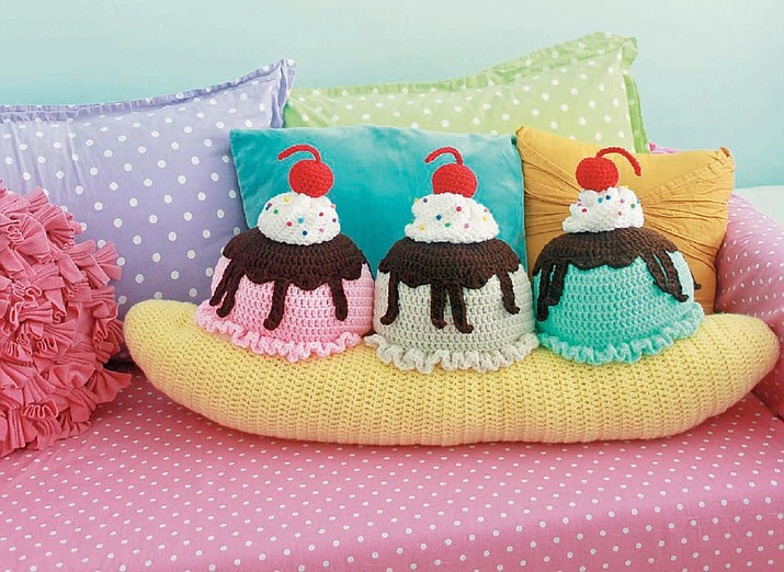 "This photo provided by Quarto Publishing Group shows a banana split throw pillow which is featured in the book ""Crocheted Abode a La Mode: 20 Yummy Crochet Projects for Your Home,"" by Twinkie Chan. (Quarto Publishing Group via AP)"