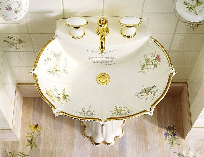 This photo provided by Kohler shows one of their Prairie Flowers and English Trellis pedestal sinks, which bring the garden indoors, to a powder room or small bath. (Kohler via AP)