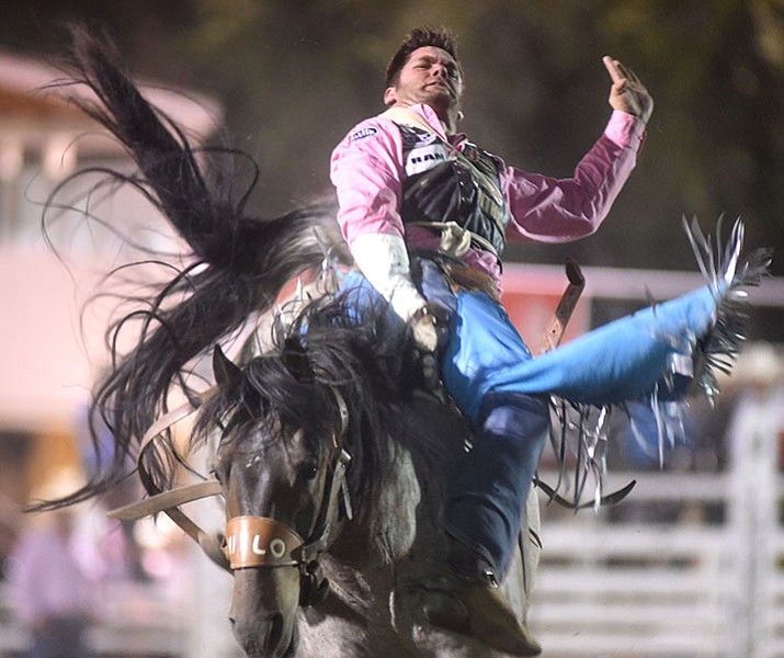 Luke Creasy rides in the Prescott Frontier Days Rodeo supporting Breast Cancer Awareness. (Les Stukenberg/Courier file)
