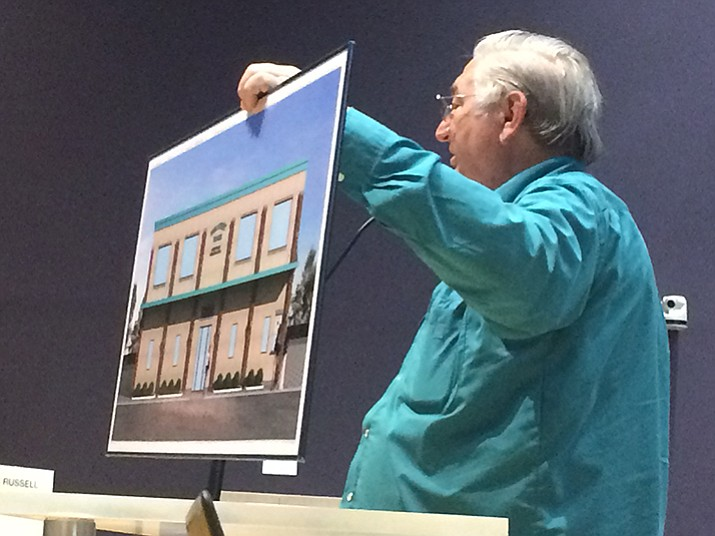Prescott Valley Performing Arts Executive Director Clyde Neville shows concept art for the planned Main Street Theater to the Prescott Valley Town Council. (Jason Wheeler/Courier)