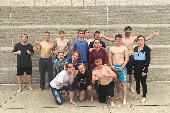 Students at Barberton High School pose for a photo after getting pepper sprayed in Barberton, Ohio. The students were pepper sprayed as part of a criminal science class and had to get permission from their parents before they participated. (Melody Steinhour via AP)