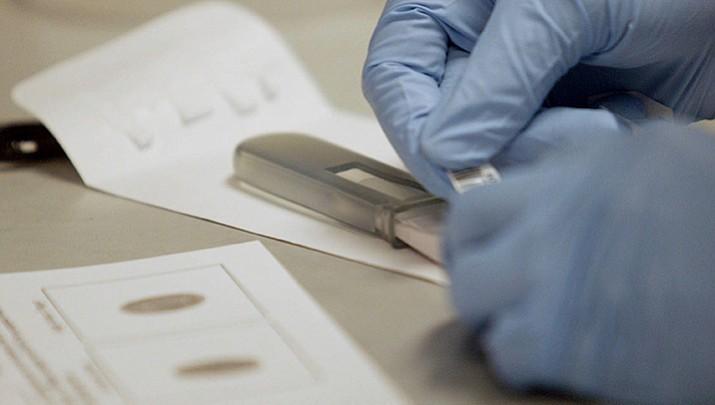 DNA testing backlog figures in  departure of state scientist