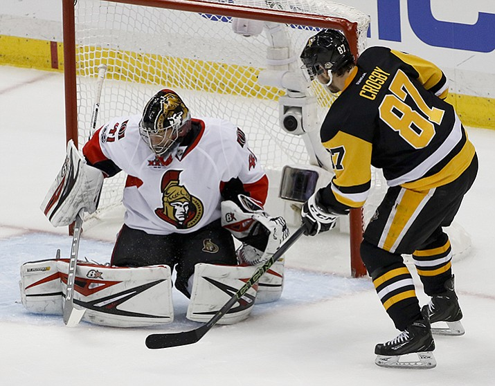 Pittsburgh Penguins' Sidney Crosby (87) scores on Ottawa Senators goalie Craig Anderson during the first period of Game 5 in the NHL hockey Stanley Cup Eastern Conference finals, Sunday, May 21, in Pittsburgh.