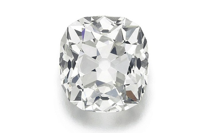 This 'Costume jewelry' diamond was purchased 30 years ago for about $15. It turned out to be a real 26.27 karat diamond and is expected to fetch about $454,000 when it is auctioned by Sotheby's next month (Sotheby's via AP)