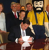 Ducey signs $1B bill for universities photo