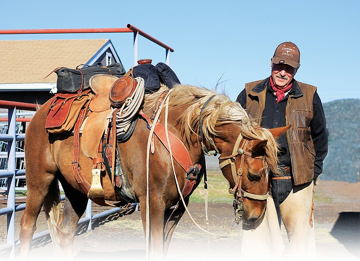George VanGuilder, of Dewey, Arizona, prepares his horse for the annual Mountain Man ride to Black Canyon City.