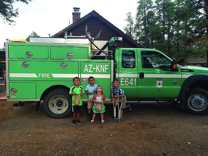 Kids learn about the U.S. Forest Service during Helper Week at KLC summer camp.