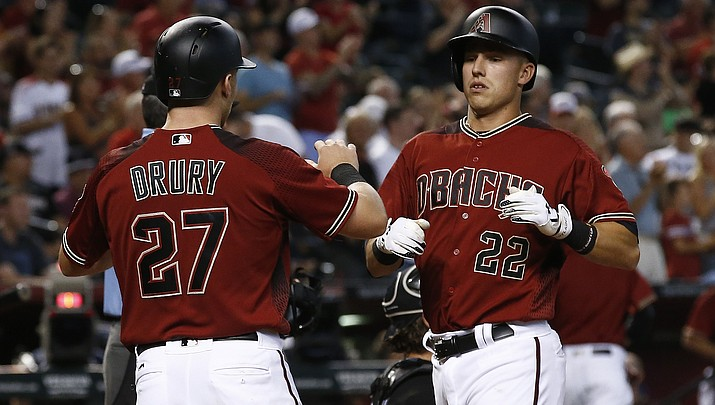 Lamb homers, D-backs sweep White Sox 8-6