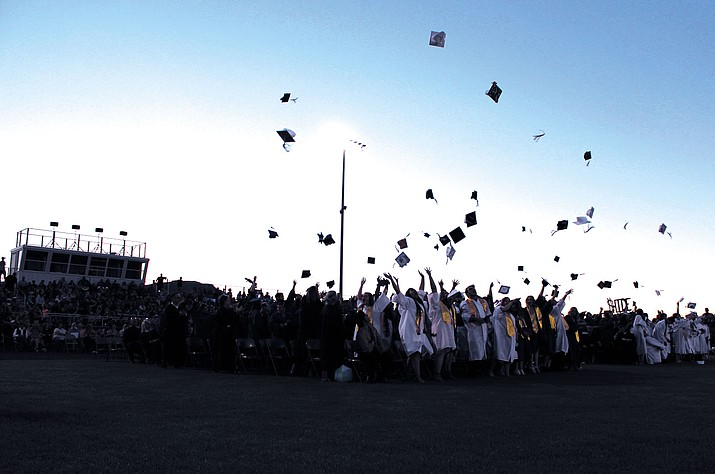 The class of 2017 tosses their caps in ritualistic celebration.