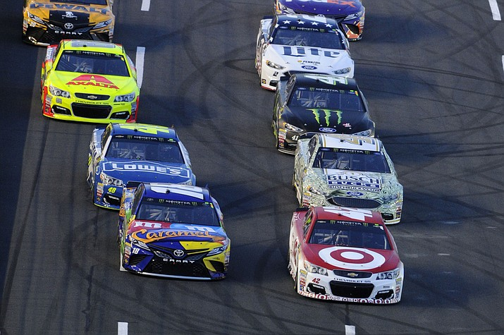 Kyle Larson, front right, and Kyle Busch, from left, lead the field at the start of the NASCAR All-Star race at the Charlotte Motor Speedway on May 20 in Concord, N.C. (Mike McCarn/AP)
