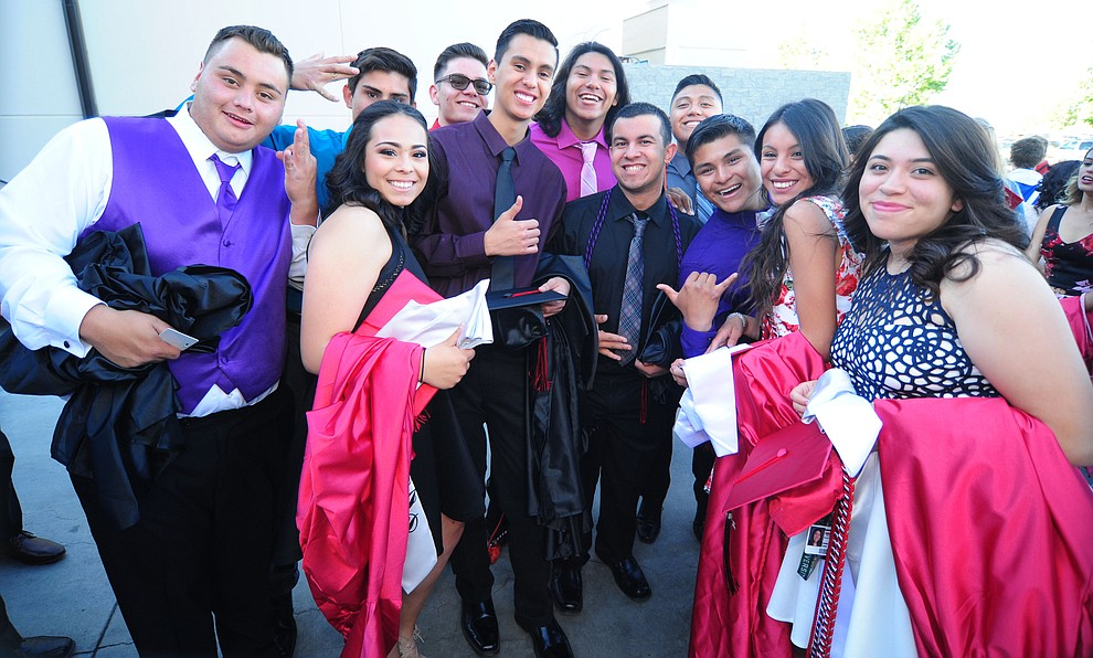 A group of friends poses for a photo before the Bradshaw Mountain Class of 2017 held their Commencement at the Prescott Valley Event Center  Thursday, May 25. The class had 346 students that earned over $5 million in scholarships and had numerous enlistees in the military service. (Les Stukenberg/Courier)