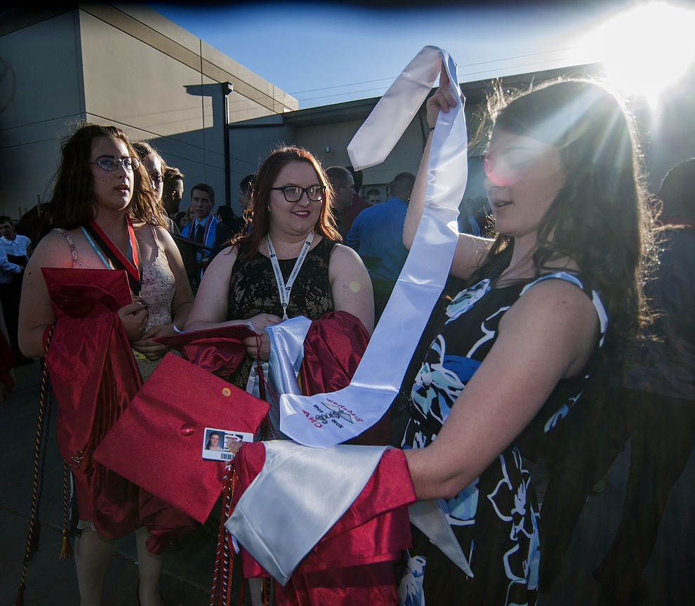 Alexis Burkett, Jesse Chisholm and Angela Senger before the Bradshaw Mountain Class of 2017 held their Commencement at the Prescott Valley Event Center  Thursday, May 25. The class had 346 students that earned over $5 million in scholarships and had numerous enlistees in the military service. (Les Stukenberg/Courier)