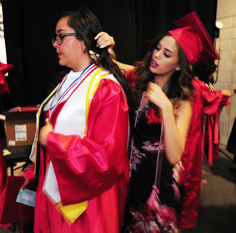 Dianna Stevens and Brooke Llanos make final preparations before the Bradshaw Mountain Class of 2017 held their Commencement at the Prescott Valley Event Center  Thursday, May 25. The class had 346 students that earned over $5 million in scholarships and had numerous enlistees in the military service. (Les Stukenberg/Courier)