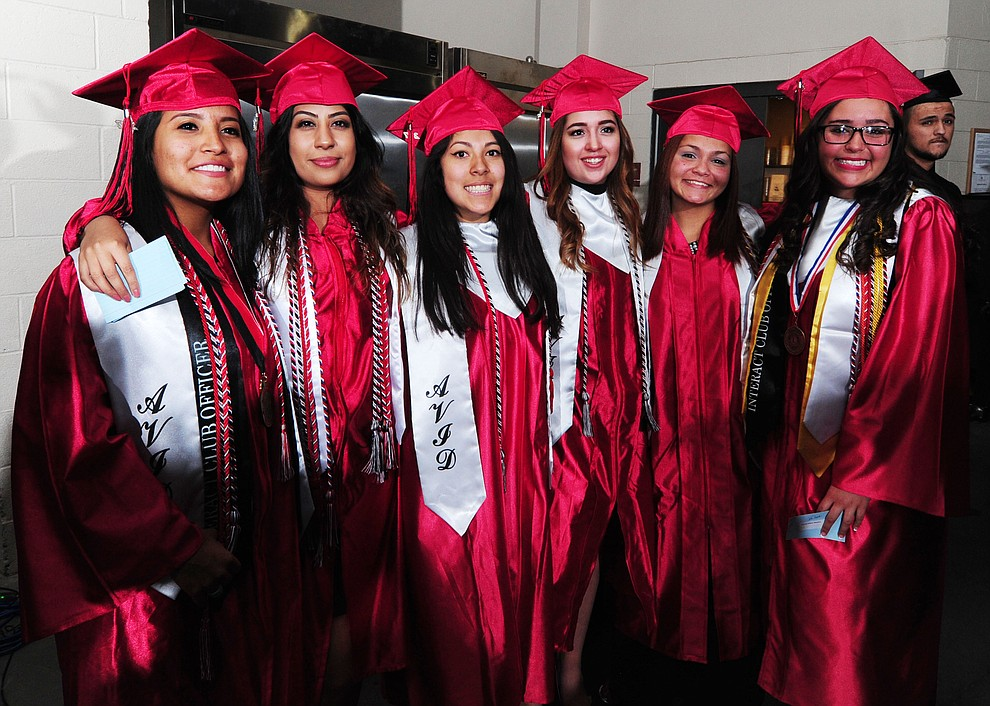 A group of friends pose for a photo before the Bradshaw Mountain Class of 2017 held their Commencement at the Prescott Valley Event Center  Thursday, May 25. The class had 346 students that earned over $5 million in scholarships and had numerous enlistees in the military service. (Les Stukenberg/Courier)