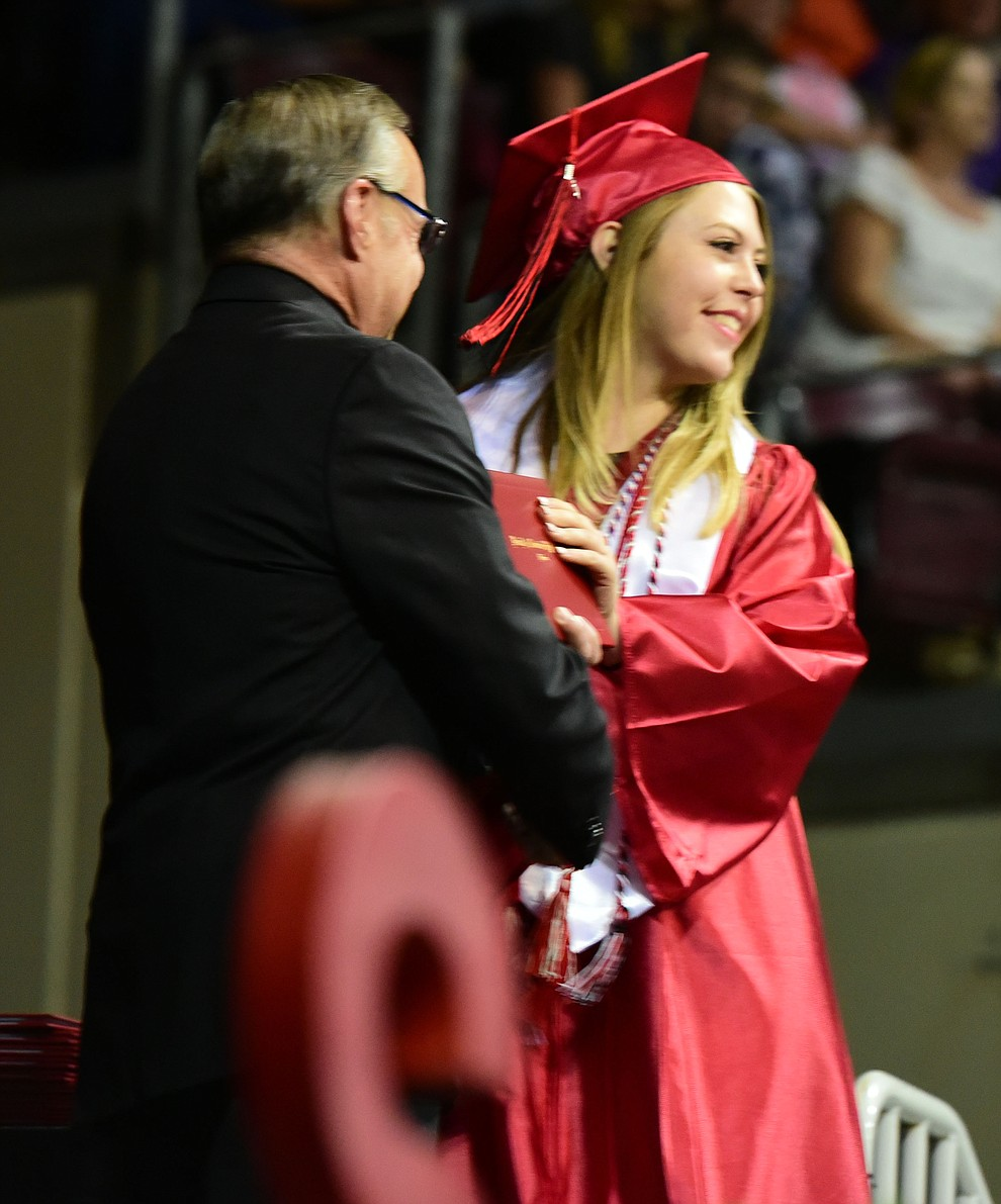 Ivie Vaca receives her diploma as the Bradshaw Mountain Class of 2017 held their Commencement at the Prescott Valley Event Center  Thursday, May 25. The class had 346 students that earned over $5 million in scholarships and had numerous enlistees in the military service. (Les Stukenberg/Courier)