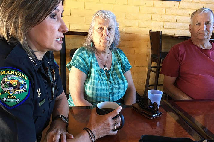Camp Verde Marshal Nancy Gardner, pictured, and Animal Control Officer Stave Ganis talk with Camp Verde residents Monday, May 22 at Thanks a Latte during the department's monthly Coffee with a Cop. (Photo by Bill Helm)