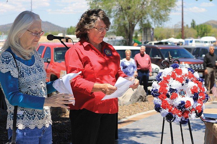 Auxiliary members of the Matthew J. Broehm VFW Post 12128 conduct a wreath laying ceremony on Memorial Day weekend 2016.