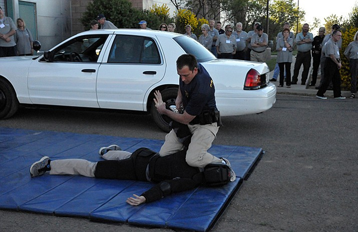 Photo: Northern Arizona Regional Training Academy (NARTA) recruits Greg Grahlmann (on top) and Wyatt Novak (on ground) perform a scenario during the spring 2017 Citizens' Police Academy.