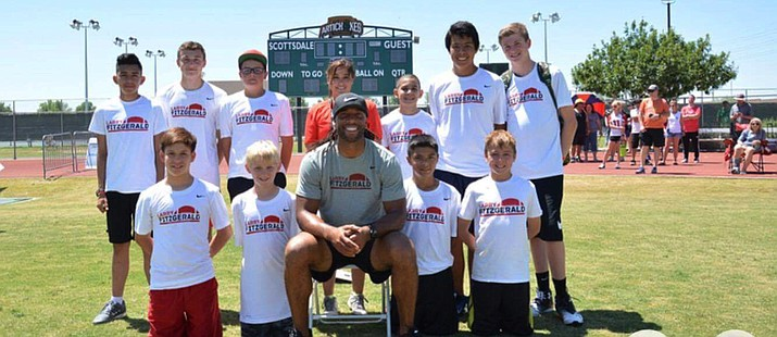 About 800 kids attended the Larry Fitzgerald Procamp at Scottsdale Community College on May 13-14 and about half dozen were from Cottonwood. Also Mingus Union head football coach Bob Young and Mountain View Prep PE teacher Bri Young coached at the camp. (Photos courtesy of Bri Young)