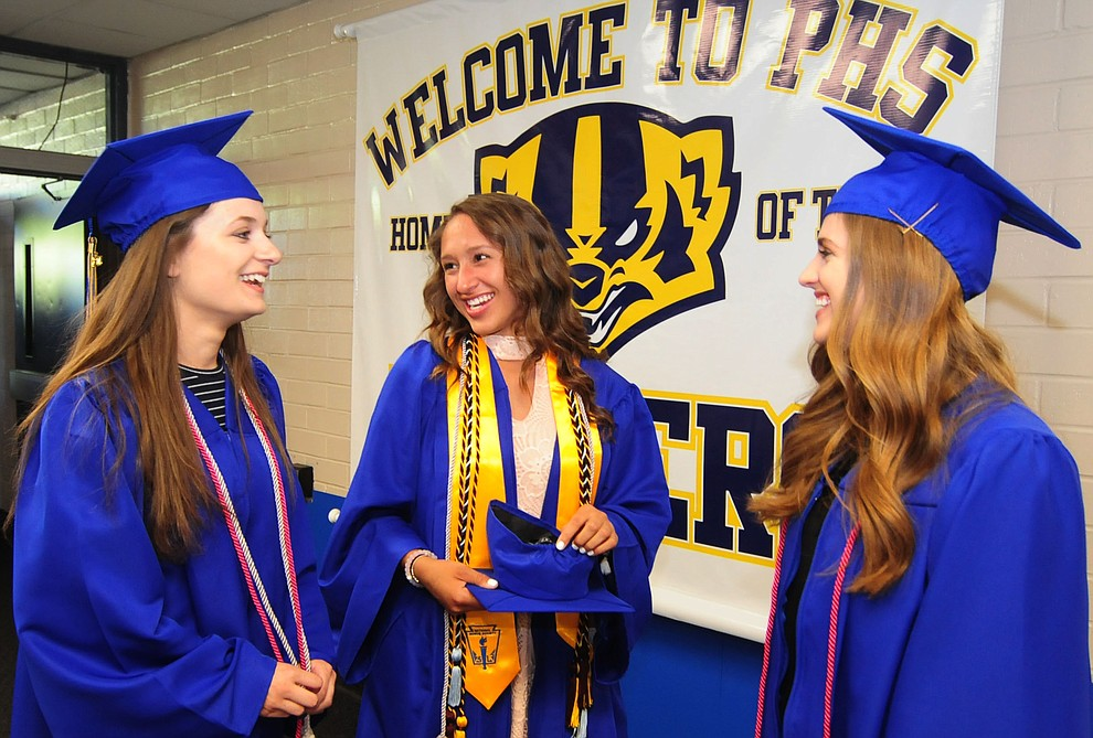 Grace Doyle, Keiana Vicente and Delaney Dandos share a laugh before the 345 members of the Prescott High School Class of 2017 held their Commencement on Bill Shepherd Field Friday, May 26. (Les Stukenberg/Courier)