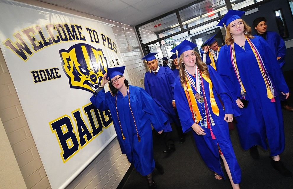 Almost graduates enter the school before the 345 members of the Prescott High School Class of 2017 held their Commencement on Bill Shepherd Field Friday, May 26. (Les Stukenberg/Courier)