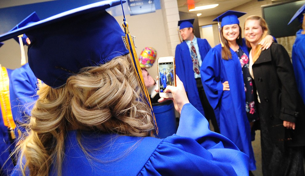 Janelle Naid takes a photo of Kaitlin O'Driscoll and Rachael Rapee before the 345 members of the Prescott High School Class of 2017 held their Commencement on Bill Shepherd Field Friday, May 26. (Les Stukenberg/Courier)