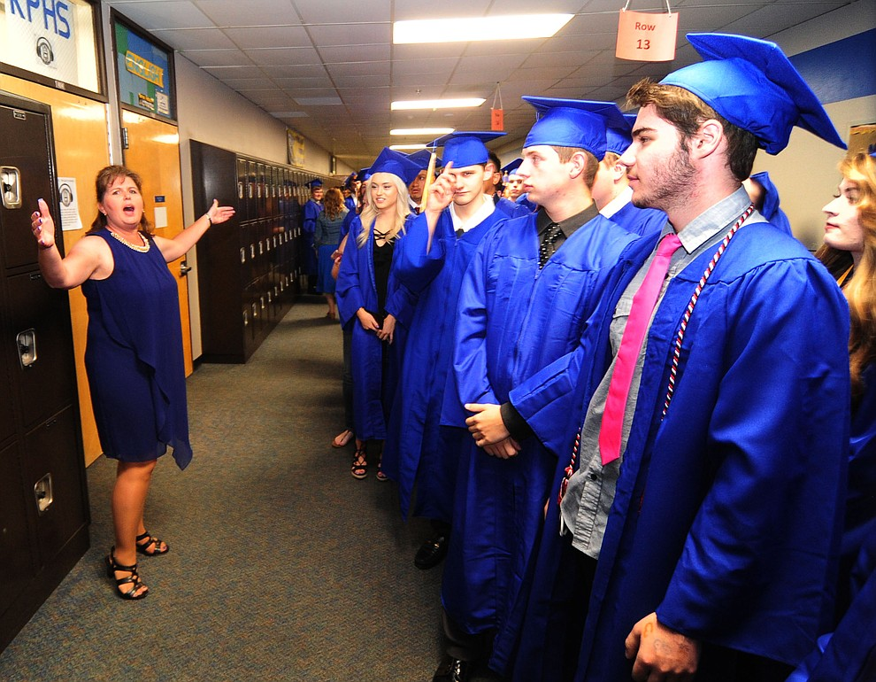 Principal Stephanie Hillig gives last minute instructions as the 345 members of the Prescott High School Class of 2017 held their Commencement on Bill Shepherd Field Friday, May 26. (Les Stukenberg/Courier)