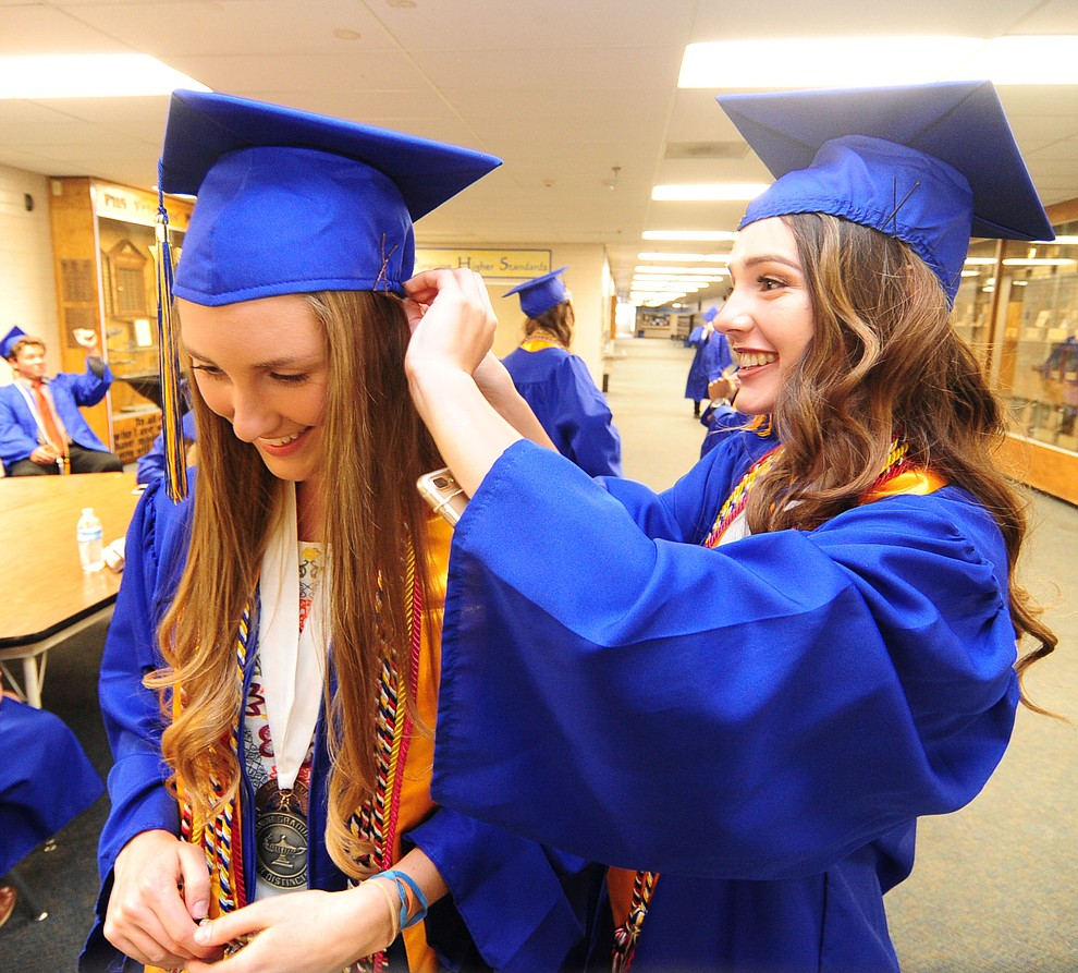 Devan Cargill and Anna Miller before the 345 members of the Prescott High School Class of 2017 held their Commencement on Bill Shepherd Field Friday, May 26. (Les Stukenberg/Courier)