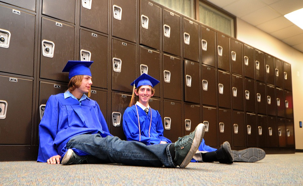 Paul Snyder and Jayce Jensen find a quiet spot before the 345 members of the Prescott High School Class of 2017 held their Commencement on Bill Shepherd Field Friday, May 26. (Les Stukenberg/Courier)