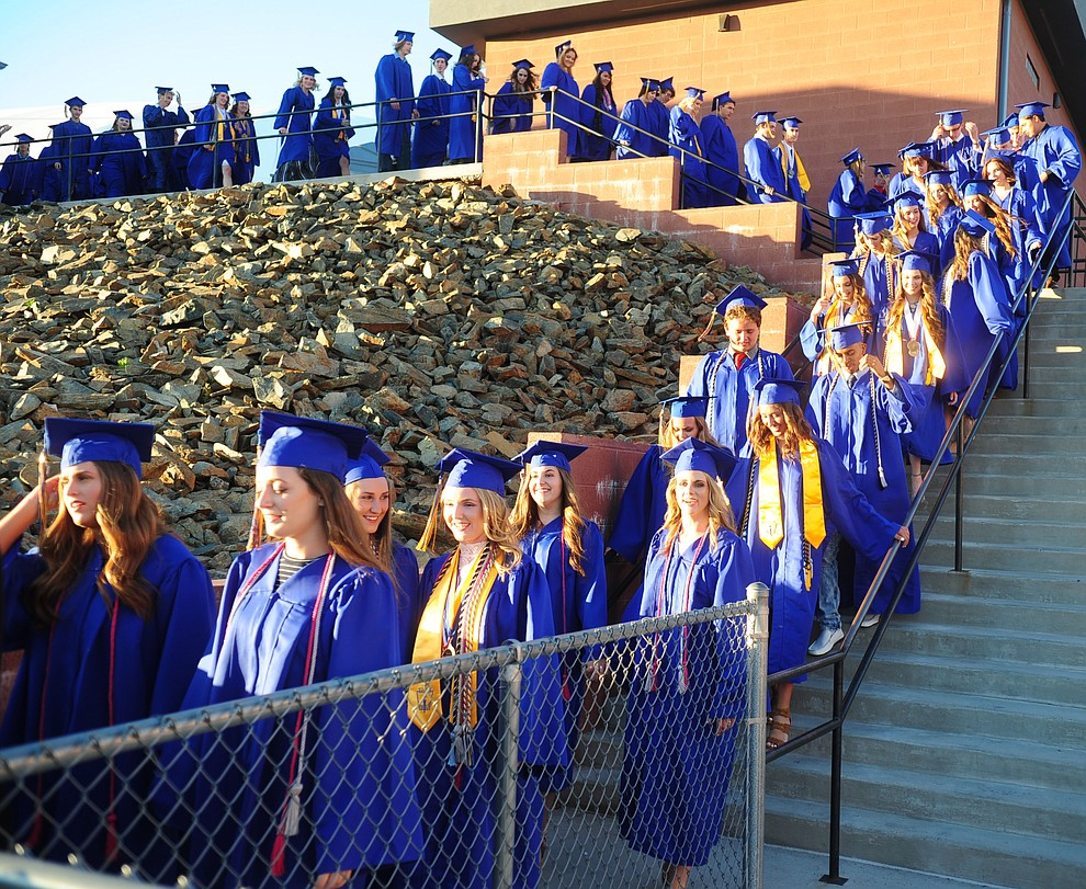 Students march onto the field as the 345 members of the Prescott High School Class of 2017 held their Commencement on Bill Shepherd Field Friday, May 26. (Les Stukenberg/Courier)