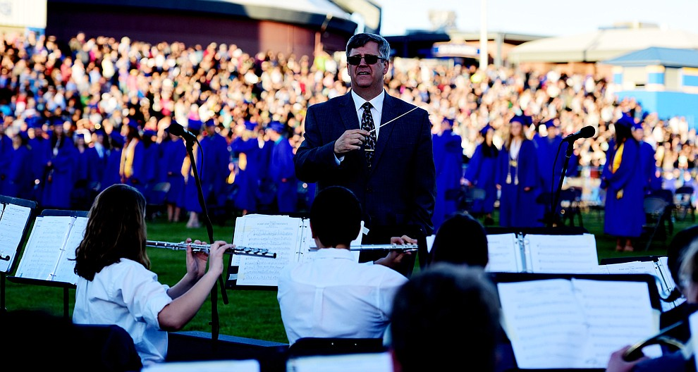 Dan Bradstreet conducts the band as the 345 members of the Prescott High School Class of 2017 held their Commencement on Bill Shepherd Field Friday, May 26. (Les Stukenberg/Courier)