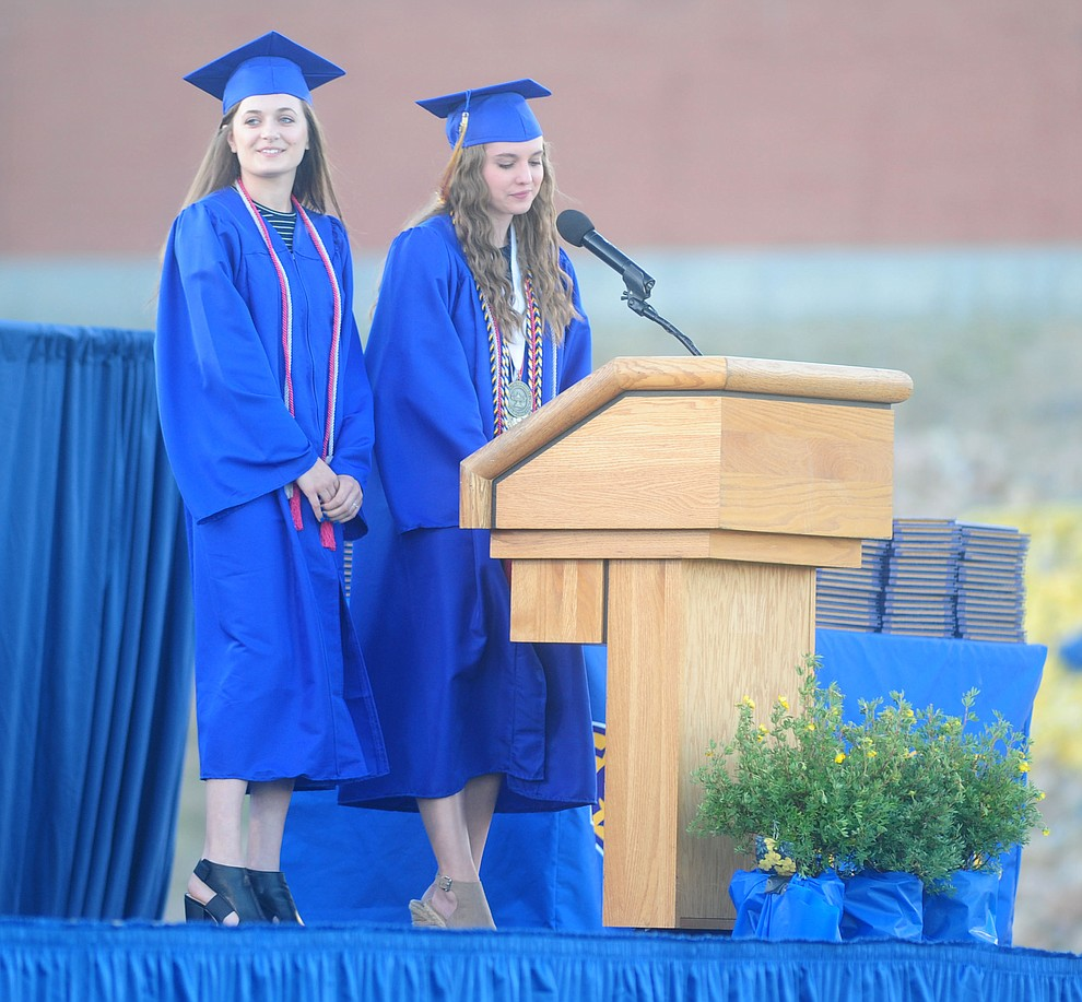 Emma Kelley and Grace Doyle speak as the 345 members of the Prescott High School Class of 2017 held their Commencement on Bill Shepherd Field Friday, May 26. (Les Stukenberg/Courier)