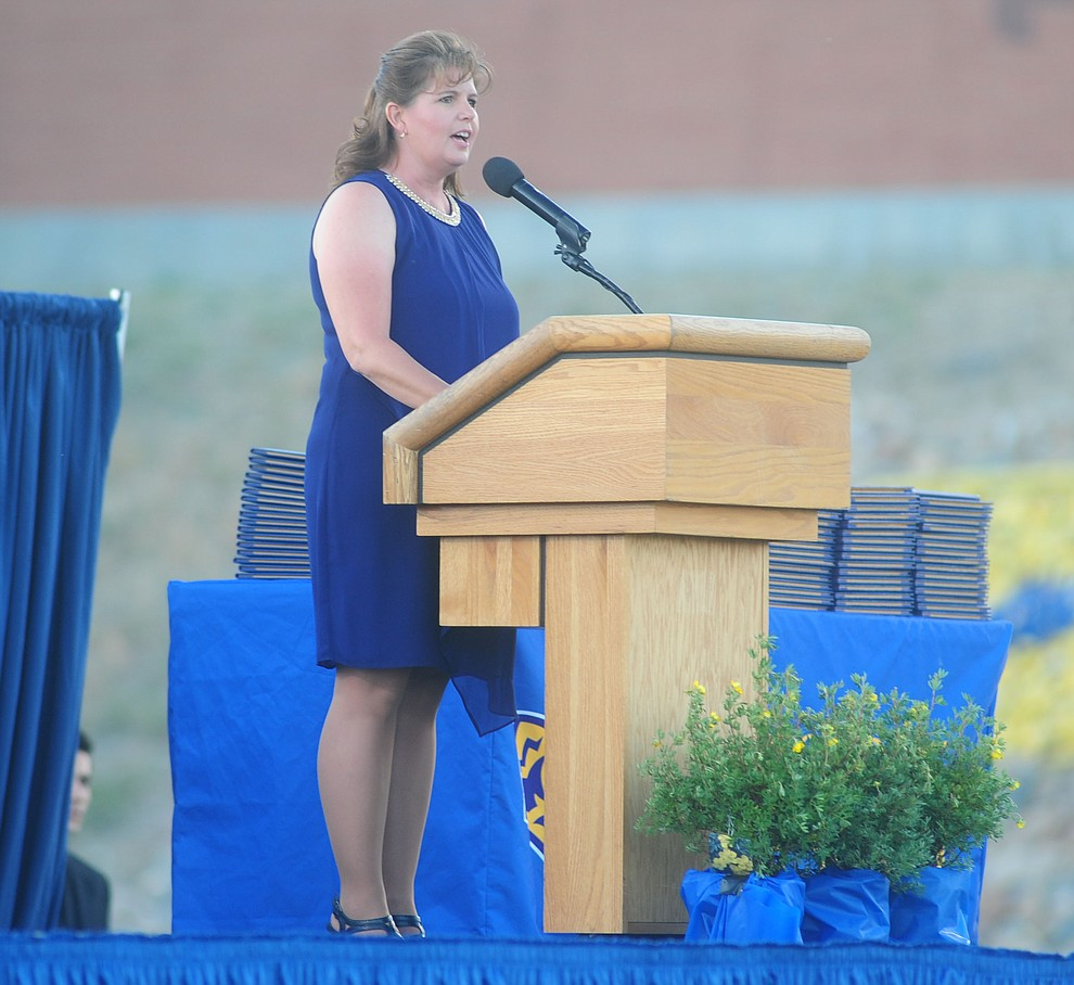 Principal Stephanie Hillig adresses the 345 members of the Prescott High School Class of 2017 as they held their Commencement on Bill Shepherd Field Friday, May 26. (Les Stukenberg/Courier)