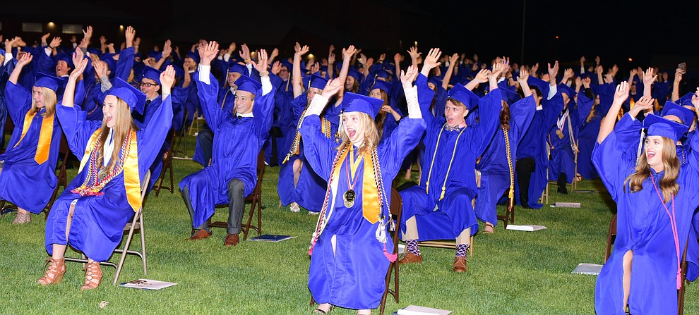 """Doing the """"roller coaster"""" one last time as the 345 members of the Prescott High School Class of 2017 held their Commencement on Bill Shepherd Field Friday, May 26. (Les Stukenberg/Courier)"""