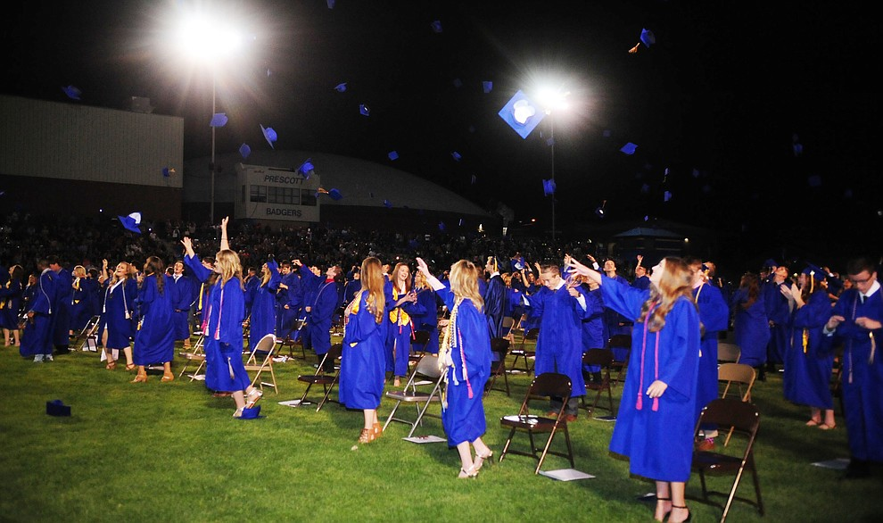Tossing of their caps into the air as the 345 members of the Prescott High School Class of 2017 held their Commencement on Bill Shepherd Field Friday, May 26. (Les Stukenberg/Courier)