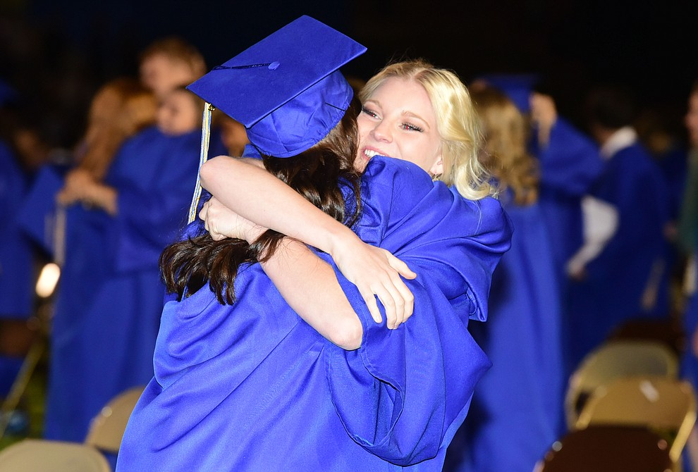 Loving hugs after the 345 members of the Prescott High School Class of 2017 held their Commencement on Bill Shepherd Field Friday, May 26. (Les Stukenberg/Courier)