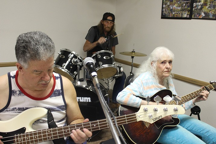 Todd Maehren, left, plays bass with Shaen Johnson on guitar and Ernie on drums at a Thursday afternoon jam session at Kathryn Heidenreich Adult Center.